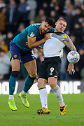Hull City defender Ryan Tafazolli holds on to Derby County forward Martyn Waghorn during the EFL Sky Bet Championship match between Derby County and Hull City at the Pride Park, Derby, England on 18 January 2020.
