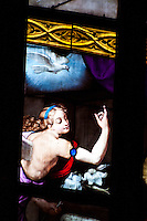 Milan, Italy, Duomo Cathedral. Stained glass window. Close-up of angel and holy dove.