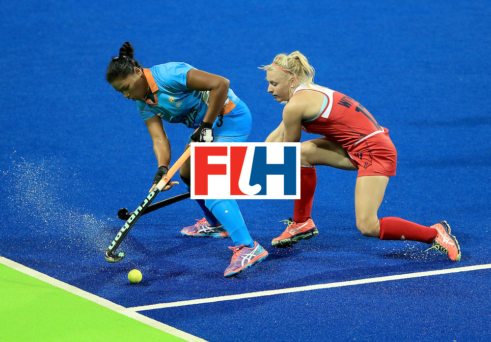 RIO DE JANEIRO, BRAZIL - AUGUST 11:  Deep Ekka #3 of India attempts to control the ball against Jill Witmer #10 of the United States during a Women's Preliminary Pool B match at the Olympic Hockey Centre on August 11, 2016 in Rio de Janeiro, Brazil.  (Photo by Sam Greenwood/Getty Images)