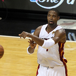Jun 19, 2012; Miami, FL, USA; Miami Heat power forward Chris Bosh (1) passes against the Oklahoma City Thunder during the first quarter in game four in the 2012 NBA Finals at the American Airlines Arena. Mandatory Credit: Derick E. Hingle-US PRESSWIRE