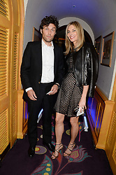 KIM HERSOV and BARRY REIGATE at the launch of Bluehouse, Samsung's Exclusive New members Club held at Annabel's, 44 Berkeley Square, London on 1st July 2013.