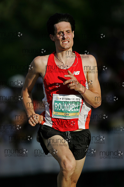 (Ottawa, ON --- May 29, 2010) JOSHUA ROUNDELL running in the 10km race during the Ottawa Race Weekend. Photograph copyright Sean Burges / Mundo Sport Images