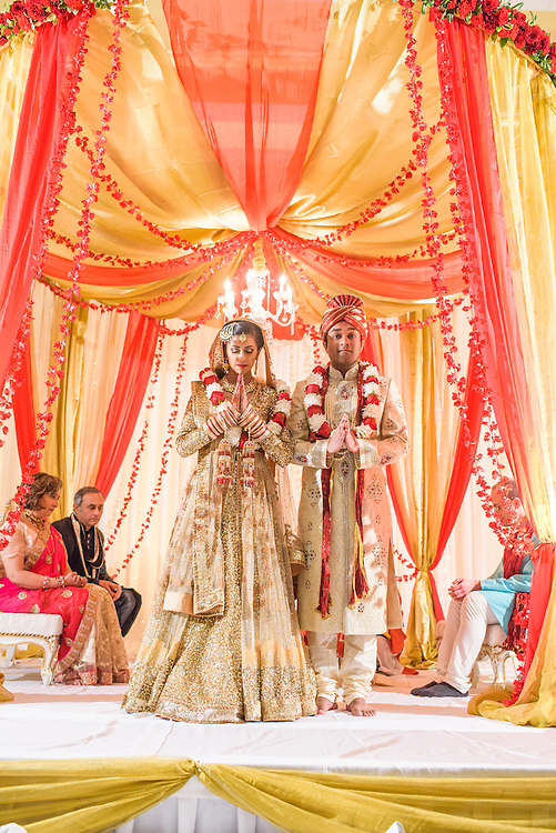 Baltimore, Maryland - December 20, 2014: Trisha Satya Pasricha and Eshwan Ramudu start the wedding ceremony with the Ganesh Puja, a prayer to Lord Ganesh, the god of wisdom, learning, good luck, and the remover of all obstacles in life. <br /> The couple, who met at Harvard, during a one of Trisha's student films, were married at the Baltimore Marriott Waterfront Hotel December 20, 2014. <br /> <br /> <br /> CREDIT: Matt Roth for The New York Times<br /> Assignment ID: 30168620A