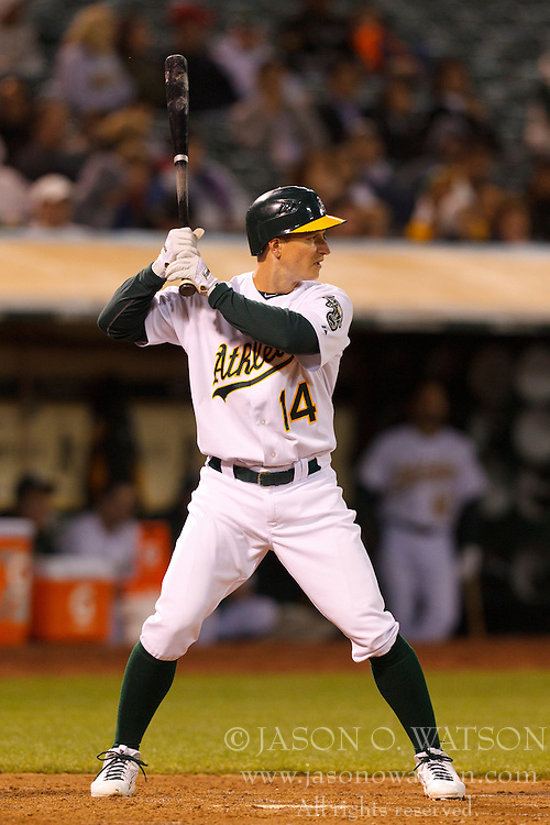May 18, 2011; Oakland, CA, USA;  Oakland Athletics second baseman Mark Ellis (14) at bat against the Minnesota Twins during the seventh inning at Oakland-Alameda County Coliseum.  Minnesota defeated Oakland 4-3 in 10 innings.