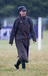 Image ©Licensed to i-Images Picture Agency. 02/08/2014. , United Kingdom. Princess Annes braves the rain at theFestival of British Eventing. Gatcombe. Picture by i-Images