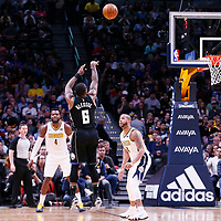 01 April 2018: Milwaukee Bucks guard Eric Bledsoe (6) takes a jump shot over Denver Nuggets guard Devin Harris (34) during the Denver Nuggets 128-125 victory over the Milwaukee Bucks, at the Pepsi Center, Denver, Colorado, USA.