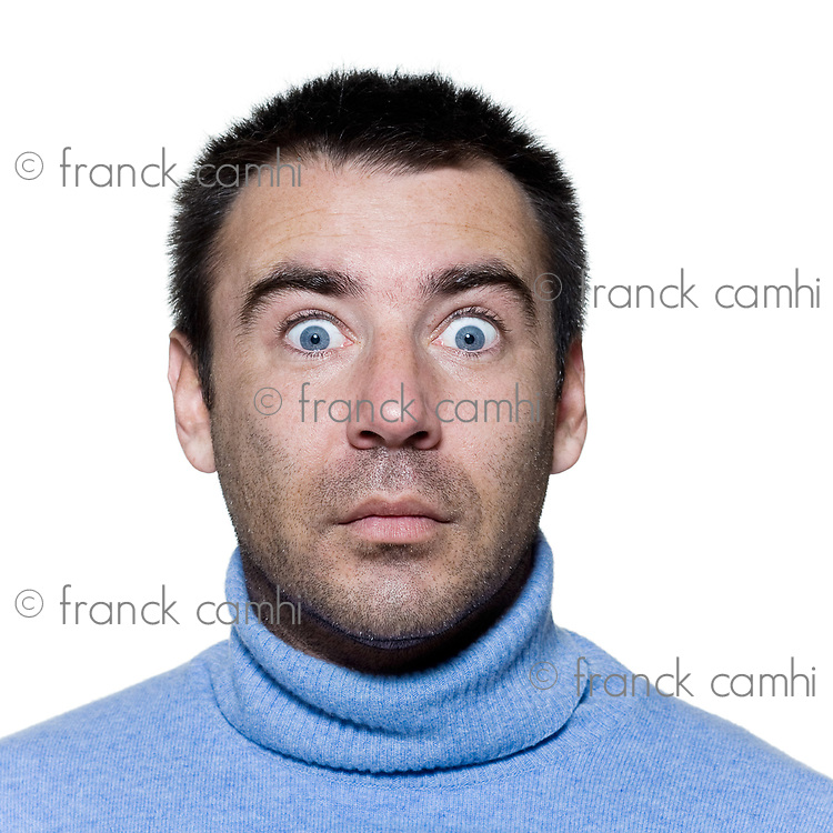 expressive portrait on isolated background of a stubble man stun surprised