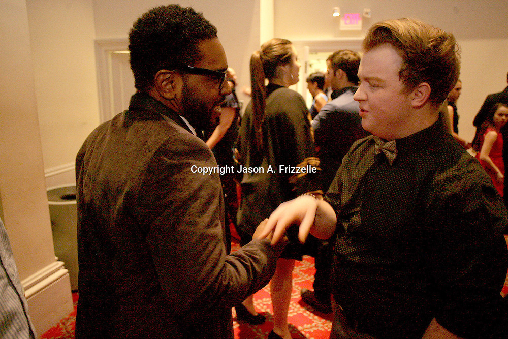 Khawon Porter, left and Alex Holland talk at the Wilmington Theater Awards at Thursday January 23, 2014 at Thalian Hall. (Jason A. Frizzelle)