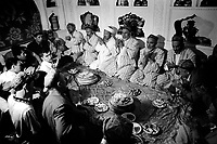 Xinjiiang Uygur Autonomous region. Kashgar. Imams, Islamic religious leaders pray and bless the groom and his family on wedding morning 2000.