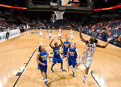 Virginia guard Monica Wright (22) beats four Morehead St. defenders to the basket. The Virginia Cavaliers women's basketball team defeated the Morehead State Eagles 88-43 at the John Paul Jones Arena in Charlottesville, VA on February 4, 2008.
