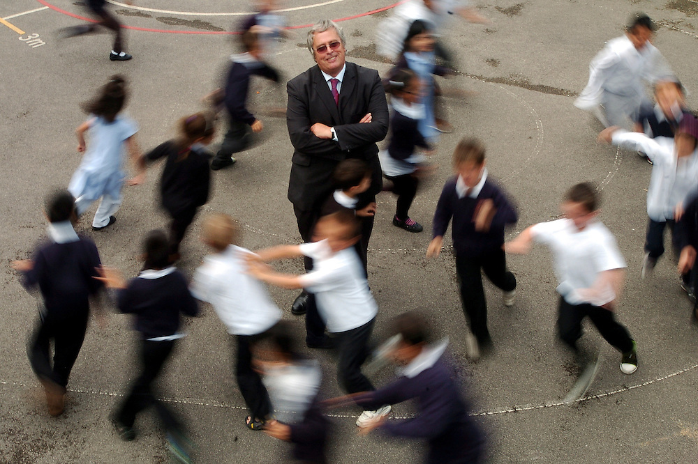 St James' School headmaster Ian Bell is pictured surrounded by children at the St James' Church of England Infant School and Nursery site on Leonard Street. Ian is stepping down as headmaster of the school as he retires at the age of 62.