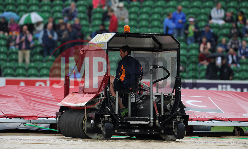 Somerset's Groundsman Rob Hake works on the wicket. - Photo mandatory by-line: Harry Trump/JMP - Mobile: 07966 386802 - 12/06/15 - SPORT - CRICKET - Somerset v Surrey - The County Ground, Taunton, England.