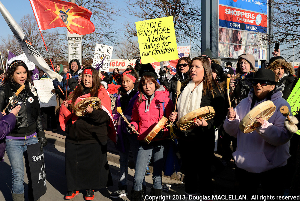 Windsor, Canada. January, 2013. Idle No More National Day of Action. March called for an 'economic slowdown' and it meets its goal. Peaceful march to Canada Border Station near Ambassador Bridge. Eight First Nations from southwestern Ontario participate. Crowd about 500 to 700. NOTE: Agefotostock exclusive, G99-1913551, for licensing go to link http://www.agefotostock.com/age/en/Stock-Images/Rights-Managed/G99-1913551