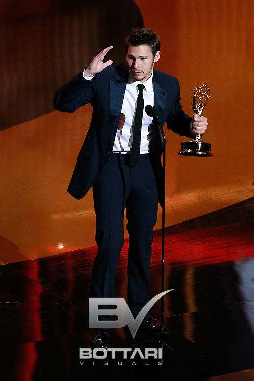Actor Scott Clifton accepts the Outstanding Younger Actor award onstage during the Daytime Emmy Awards on Sunday June 19, 2011 in Las Vegas. (AP Photo/Jeff Bottari)