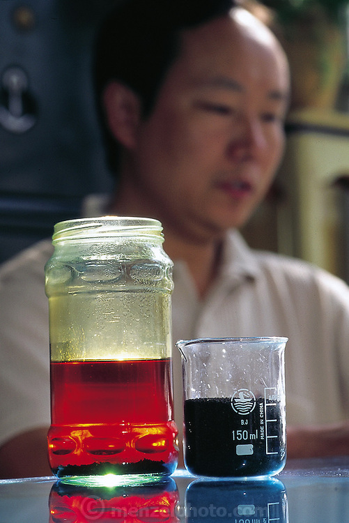 A sample of caterpillar castings tea, called chongcha. The tiny hard pellets of caterpillar excrement are steeped in hot water to produce a tea of sorts which is reputed to possess certain medicinal properties, Kunming, China. (Man Eating Bugs page 105, 101)