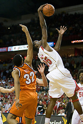 Maryland forward James Gist (15) grabs a rebound against Virginia.  The Maryland Terrapins defeated the Virginia Cavaliers men's basketball team 85-75 at the Comcast Arena in College Park, MD on January 30, 2008.