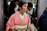 JANUARY 09: Japanese women who celebrate turning 20 years old, clad in Japanese kimono in the metro near Meiji Jingu shrine in Tokyo, on Coming of Age Day national holiday, Monday, Jan. 9, 2017. While many festive ceremonies are held in various venues throughout Japan, The day is marked by those who turned 20 in the past year after April 1 or will be 20 before March 31 this year. 09/01/2017-Tokyo, JAPAN