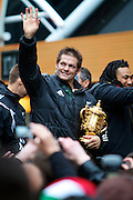 Richie McCaw of the New Zealand All Blacks, 2011 Rugby World Cup champions parades through the streets of Wellington. Rain and strong wind wasn't enough to deter Wellington locals from welcoming their heroes.