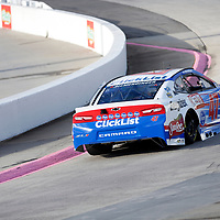 AJ Allmendinger (47) races through turn three to practice  for the First Data 500 at Martinsville Speedway in Martinsville, Virginia.