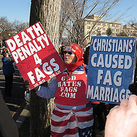 An anti-gay demonstrator holds signs and marches outside the Supreme Court in Washington D.C. on Tuesday, March 26, 2013, where the justices were hearing arguments on California's voter approved ban on same-sex marriage called Proposition 8. The Supreme Court waded into the fight over same-sex marriage Tuesday, at a time when public opinion is shifting rapidly in favor of permitting gay and lesbian couples to wed, but 40 states don't allow it. (AP Photo/ Alex Menendez)