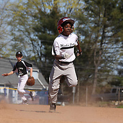 A young baseballer  runs hard towards second base during the Norwalk Little League baseball competition at Broad River Fields,  Norwalk, Connecticut. USA. Photo Tim Clayton