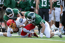 19 September 2015:  Sammy Sasso sacked by Sean Garvey with an assist by Tyler Faheyduring an NCAA division 3 football game between the Simpson College Storm and the Illinois Wesleyan Titans in Tucci Stadium on Wilder Field, Bloomington IL