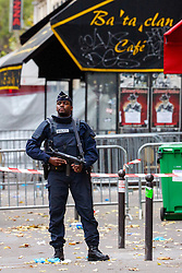 © Licensed to London News Pictures. 16/11/2015. Paris, France. French police patrolling outside Bataclan Cafe in Paris, France following the Paris terror attacks on Monday, 16 November 2015. Photo credit: Tolga Akmen/LNP