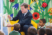"© Licensed to London News Pictures. 13/10/2014. London, UK. Nick Clegg reads from ""Mr Wolfs Pancakes"" The Deputy Prime Minister, Nick Clegg, visits Greenside Primary School in Shepherd's Bush on Monday 13th October 2014 to launch a new campaign called Primary Futures – a new strand of the Inspiring the Future campaign. Photo credit : Stephen Simpson/LNP"