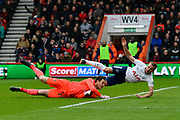 Kane injured - Harry Kane (10) of Tottenham Hotspur tumbles over Asmir Begovic (27) of AFC Bournemouth and is injued after getting his foot stuck under the goal keeper and twisting it badly during the Premier League match between Bournemouth and Tottenham Hotspur at the Vitality Stadium, Bournemouth, England on 11 March 2018. Picture by Graham Hunt.