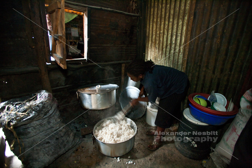 Nairobi, June 2010 -  food is prepared for hundreds of kids in this primitive kitchen with no real furniture and a simple charcoal stove at the St. Michael's children's educational center. F