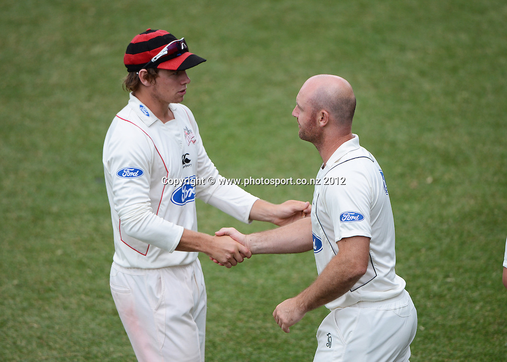 Captains Tom Latham and Gareth Hopkins shake hands at the end of the match. Plunket Shield Cricket, Auckland Aces v Canterbury Wizards at Eden Park Outer Oval. Auckland on Wednesday 19 December 2012. Photo: Andrew Cornaga/Photosport.co.nz