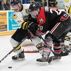 TRENTON, ON  - MAY 5,  2017: Canadian Junior Hockey League, Central Canadian Jr. &quot;A&quot; Championship. The Dudley Hewitt Cup. Game 7 between The Georgetown Raiders and The Powassan Voodoos.  Eric Nagy #5 of the Powassan Voodoos and Josh Dickinson #28 of the Georgetown Raiders battle for the puck during the second period <br /> (Photo by Amy Deroche / OJHL Images)