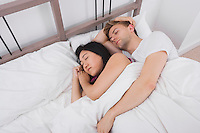 Multiethnic couple resting in bed