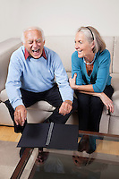 Happy senior woman looking at spouse laughing