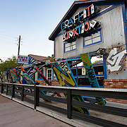 Picnic tables are stacked against a rail at Graffiti Junction restaurant due to a stay at home order that was issued by Orange County government on Friday, March 27, 2020 in Orlando, Florida.  (Alex Menendez via AP)