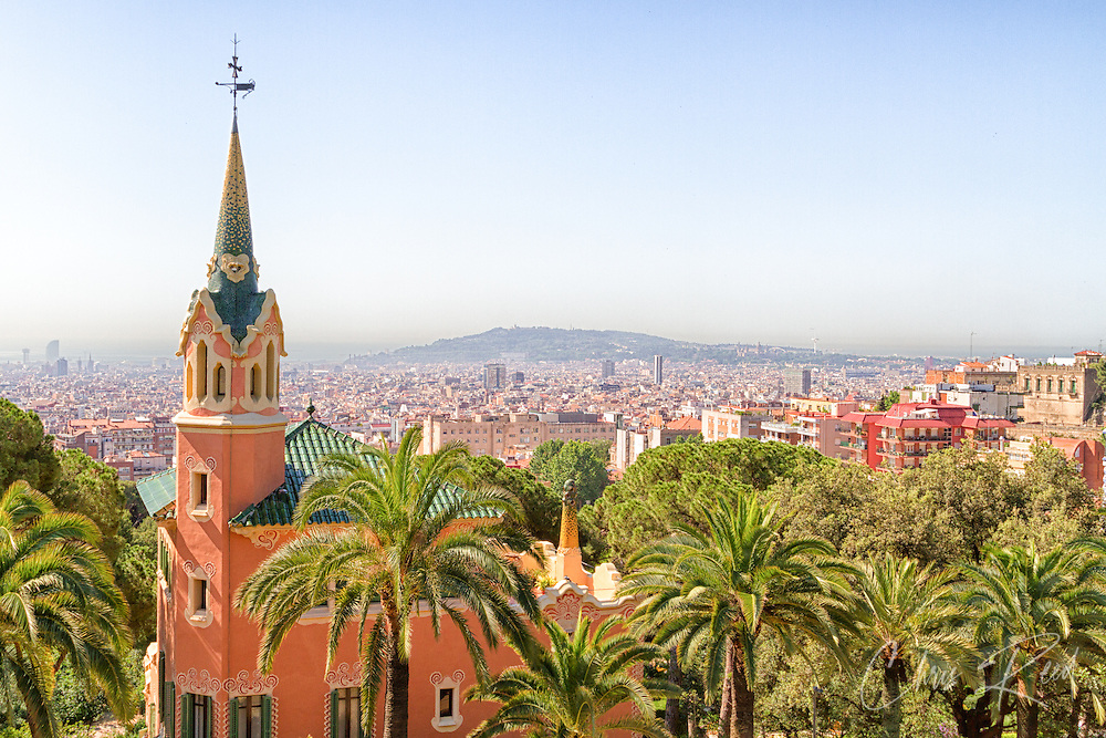 Spain, Barcelona. A structure in Antoni Gaudi's Park Güell overlooking the Barcelona landscape.