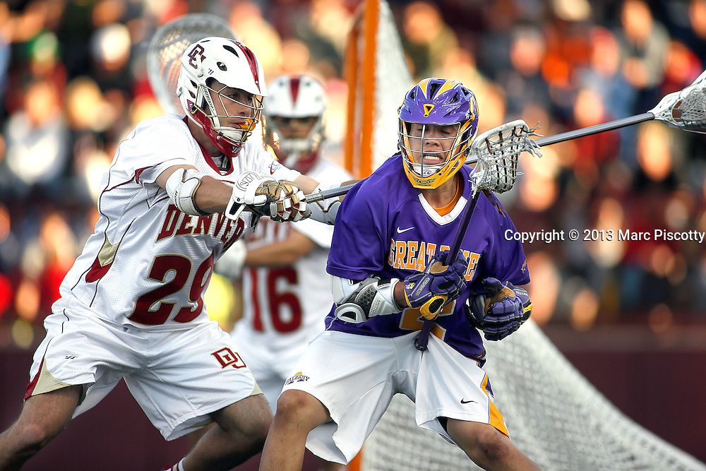 SHOT 5/11/13 7:10:15 PM - Denver's Kyle Hercher #29 plays defense on Albany's Miles Thompson #2 during their first round NCAA Tournament lacrosse game at the Peter Barton Lacrosse Stadium on the University of Denver campus Saturday May 11, 2013. The University of Denver won the game 19-14 to advance. (Photo by Marc Piscotty / © 2013)