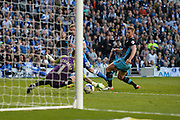 Sheffield Wednesday goalkeeper Keiren Westwood (1) saves a shot on target by Brighton striker (on loan from Manchester United), James Wilson (21) during the Sky Bet Championship play-off second leg match between Brighton and Hove Albion and Sheffield Wednesday at the American Express Community Stadium, Brighton and Hove, England on 16 May 2016. Photo by David Charbit.