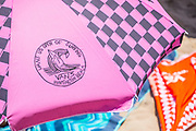 Pink Check US Open of Surfing Sun Umbrella on the Beach