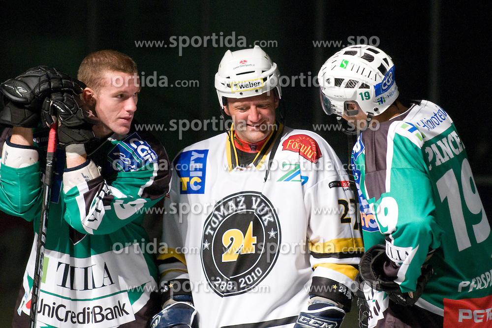 Rok Rojsek talking with Anze Ropret and Ziga Pance in Tomaz Vnuk's exhibition game between team HDD Tilia Olimpija and team 24 Ever on August 28, in Ljubljana, Slovenia. (Photo by Matic Klansek Velej / Sportida)