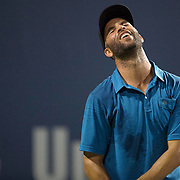 August 21, 2014, New Haven, CT:<br /> James Blake reacts during the Men's Legends Event on day seven of the 2014 Connecticut Open at the Yale University Tennis Center in New Haven, Connecticut Thursday, August 21, 2014.<br /> (Photo by Billie Weiss/Connecticut Open)