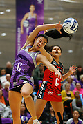 Holly Fowler of the Stars with an intercept against Kimiora Poi of the Tactix. 2018 ANZ Premiership netball match, Stars v Tactix at Pulman Arena, Auckland, New Zealand. 18 June 2018 © Copyright Photo: Anthony Au-Yeung / www.photosport.nz