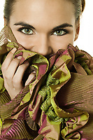 studio shot portrait of a beautiful brunette green eyes young woman on white background wearig silk scarf