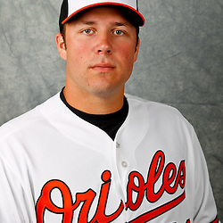 March 1, 2012; Sarasota, FL, USA; Baltimore Orioles starting pitcher Tommy Hunter (29) poses for a portrait during photo day at the spring training headquarters.  Mandatory Credit: Derick E. Hingle-US PRESSWIRE
