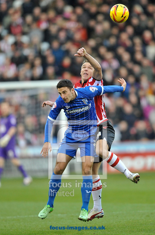 Picture by Richard Land/Focus Images Ltd +44 7713 507003<br /> 16/11/2013<br /> Anthony McMahon of Sheffield United and Chris Whelpdale of Gillingham during the Sky Bet League 1 match at Bramall Lane, Sheffield.