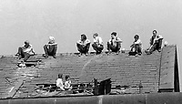 Prisoners protesting on the rooftop of the Crumlin Road Jail, Belfast, N Ireland, 20 July 1972 take advantage of the July sunshine. During the rooftop protest one prisoner was wounded by a shot from a sniper. MORE CAPTION INFO TO FOLLOW. 197207200419a Copyright Image from Victor Patterson, 54 Dorchester Park, <br /> Belfast, UK, BT9 6RJ<br /> <br /> t1: +44 28 9066 1296 (from Rep of Ireland 048 9066 1296)<br /> t2: +44 28 9002 2446 (from Rep of Ireland 048 9002 2446)<br /> m: +44 7802 353836<br /> <br /> e1: victorpatterson@me.com<br /> e2: victorpatterson@gmail.com<br /> www.victorpatterson.com<br /> <br /> Please see my Terms and Conditions of Use at www.victorpatterson.com. It is IMPORTANT that you familiarise yourself with them.<br /> <br /> Images used on the Internet must be visibly watermarked i.e. © Victor Patterson<br /> within the body of the image and copyright metadata must not be deleted. Images <br /> used on the Internet have a size restriction of 4kbs and will be chargeable at current<br />  NUJ rates unless agreed otherwise.<br /> <br /> This image is only available for the use of the download recipient i.e. television station, newspaper, magazine, book publisher, etc, and must not be passed on to any third <br /> party. It is also downloaded on condition that each and every usage is notified within 7 days to victorpatterson@me.com<br /> <br /> The right of Victor Patterson to be identified as the author is asserted in accordance with The Copyright Designs And Patents Act (1988).