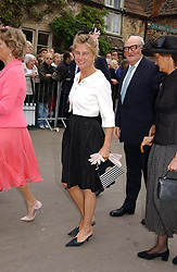 The MARCHIONESS OF DOURO (in white jacket) at the wedding of Laura parper Bowles to Harry Lopes held at Lacock, Wiltshire on 6th May 2006.<br />