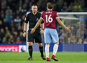 West Ham United midfielder Mark Noble (16) argues with Referee Kevin Friend during the Premier League match between Brighton and Hove Albion and West Ham United at the American Express Community Stadium, Brighton and Hove, England on 5 October 2018.