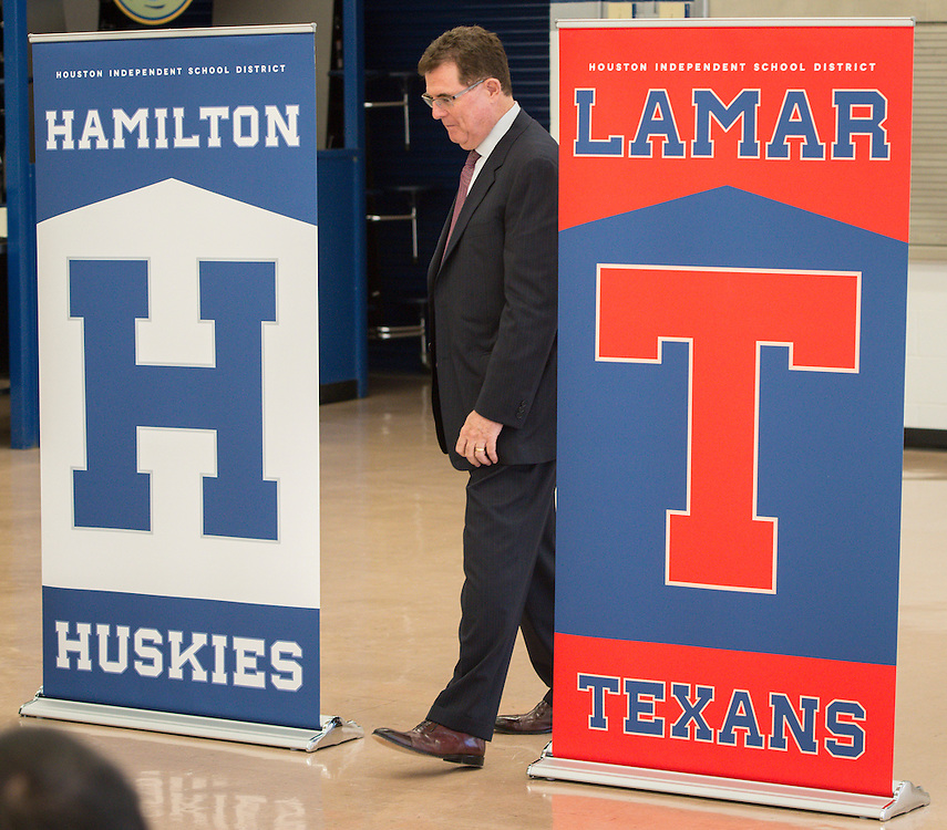 Houston ISD superintendent Dr. Terry Grier passes through banners after announcing the new mascot names for Lamar High School, Westbury High School, Welch Middle School and Hamilton Middle Schhool at Hamilton, April 15, 2014.