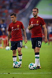 MUNICH, GERMANY - Tuesday, August 1, 2017: Liverpool's Philippe Coutinho Correia and captain Jordan Henderson warm-up before the Audi Cup 2017 match between FC Bayern Munich and Liverpool FC at the Allianz Arena. (Pic by David Rawcliffe/Propaganda)